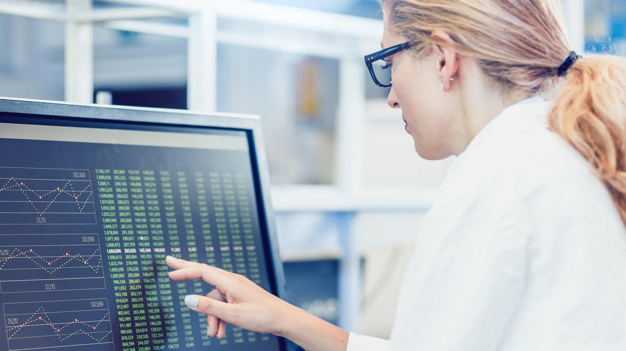 health care professional examining data