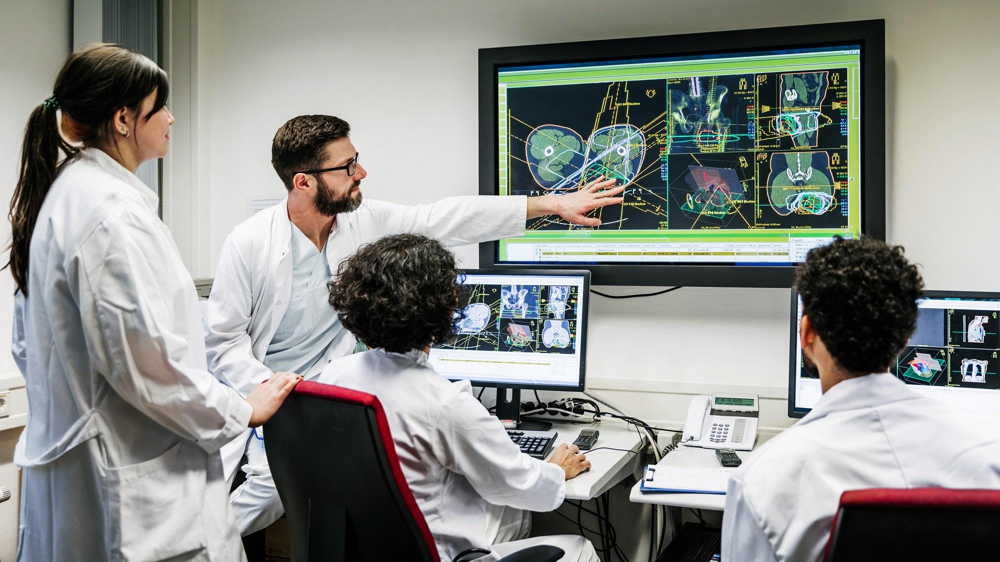 doctors looking at patient data