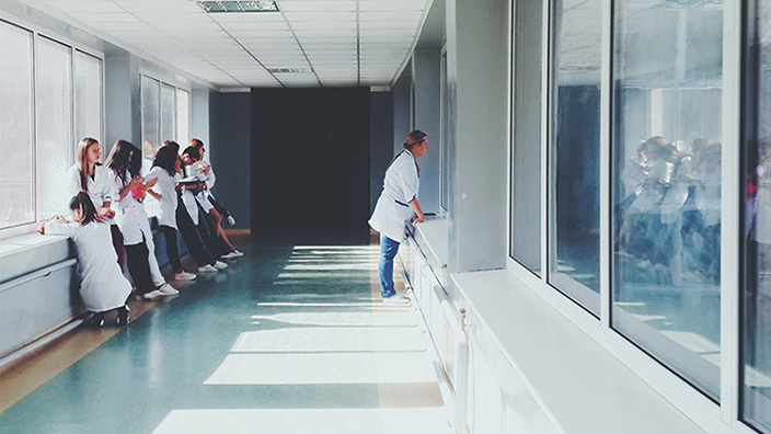 how-data-analytics-can-impact-small-community-health-care-systems_doctors in hospital hallway