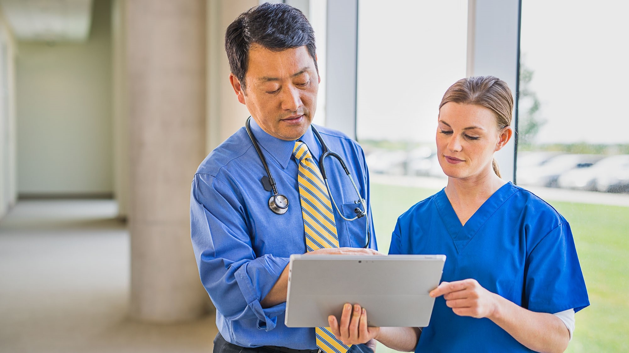 Doctor and nurse reviewing patient data