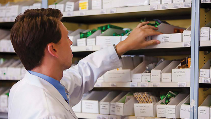 Doctor looking through supplies