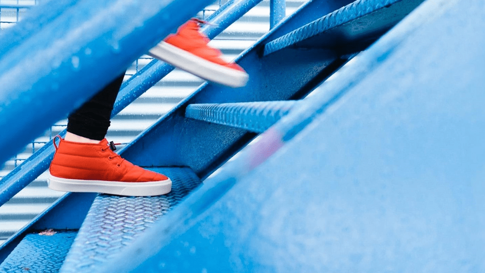 Running up blue stairs