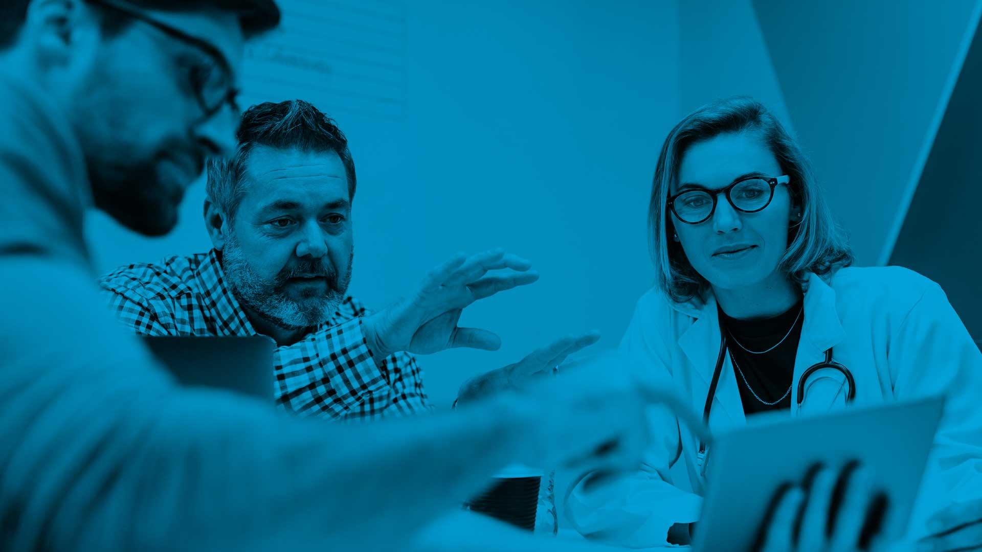 Intermountain_blog_header_doctor with people holding ipad