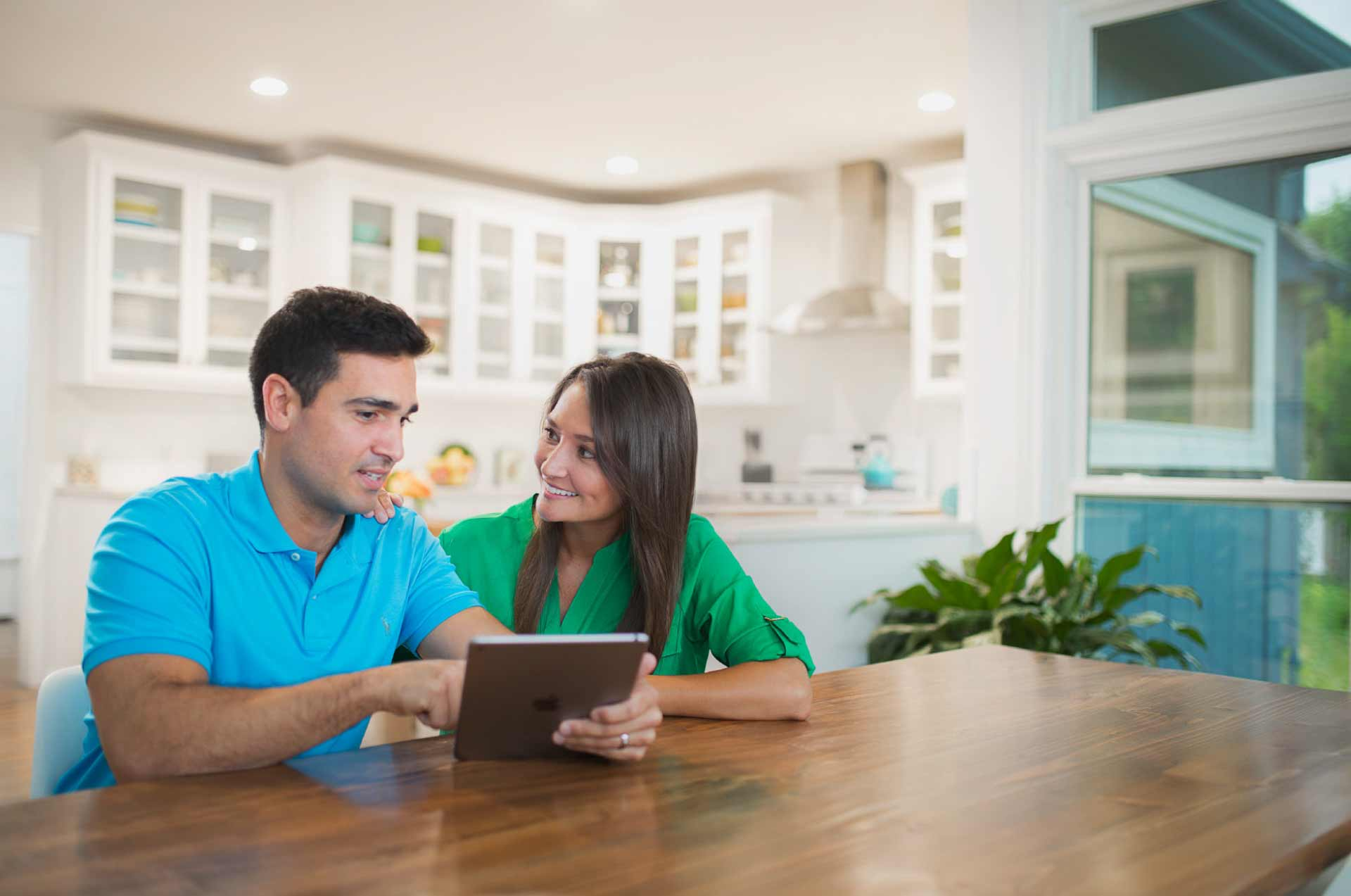 benefits-administration-new header image_people using tablet at home