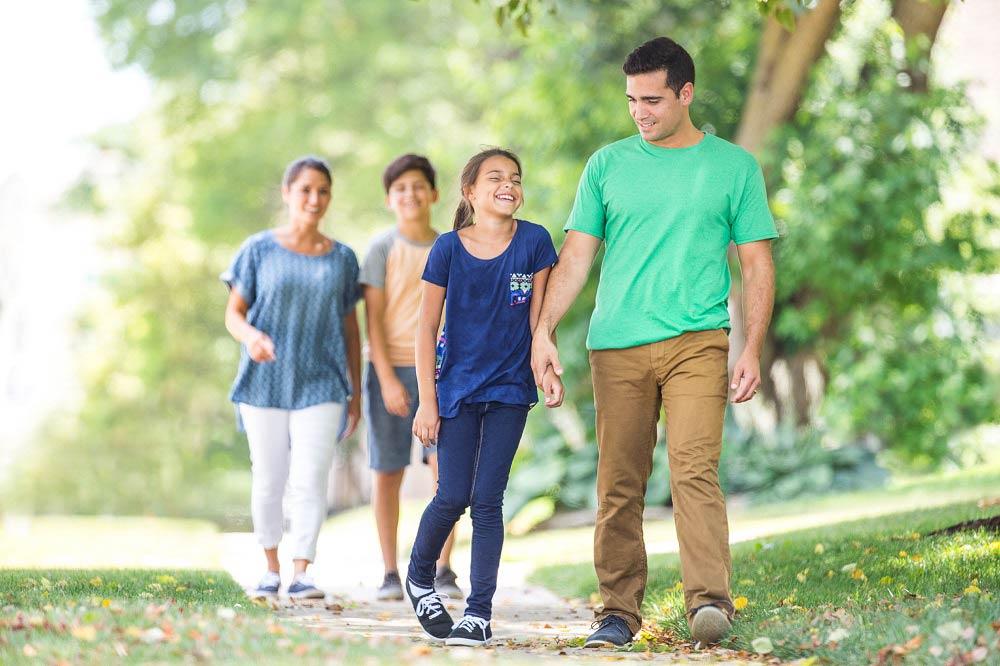 banner_family walking in park