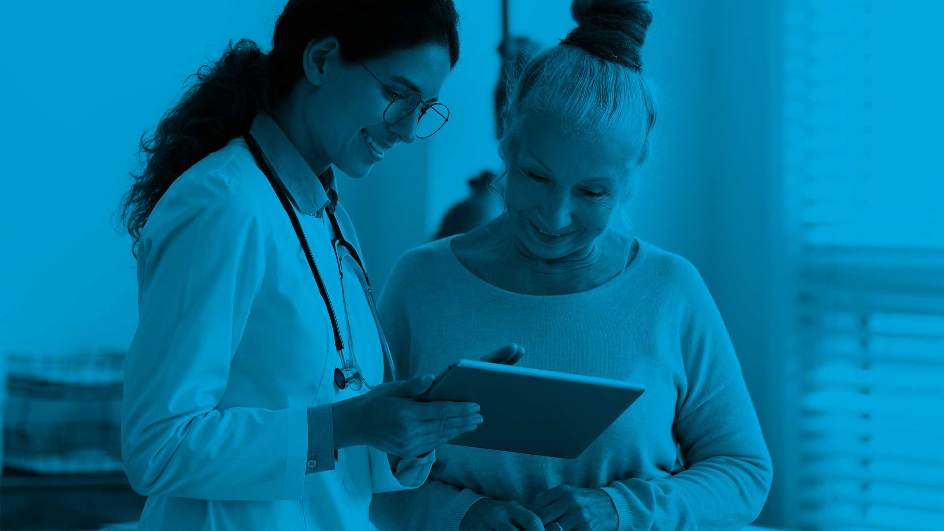 Perspectives image_doctor with patient looking at tablet blue overlay