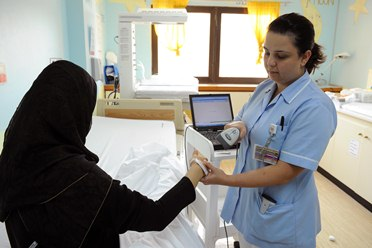 Nurse and patient at Corniche Hospital